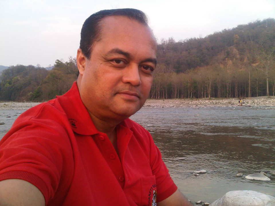 Photo of Joygopal Podder at the river